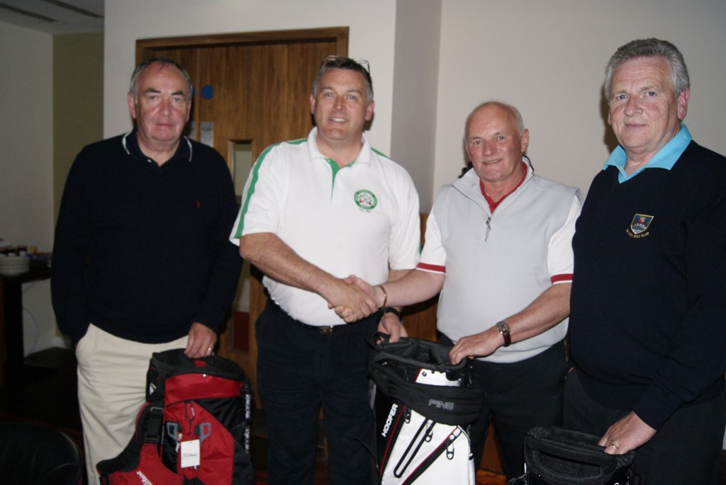 Kieran Lynam presents the overall winning team of John Joe Shanahan, Ger O Halloran and Pat O Sullivan with their winning prizes.