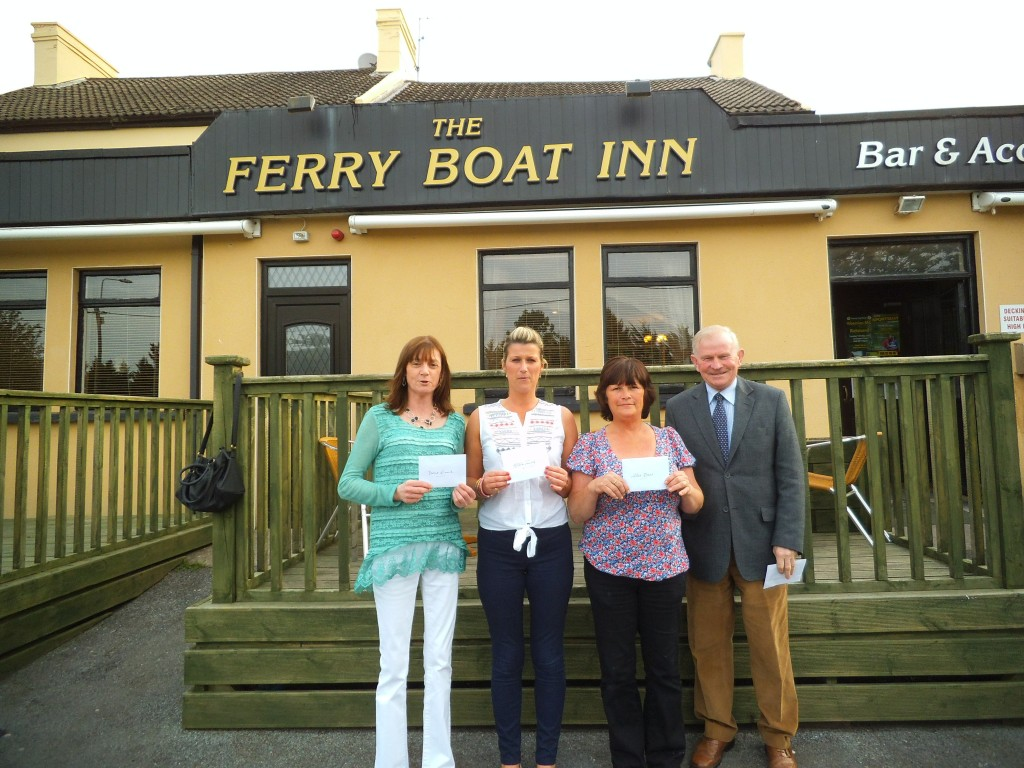 Lotto Presentation of €500 cheques, 25/5/13. From left - Geraldine Twomey (seller) representing Denis Good and Roy Maye, Debbie O'Grady representing her brother in law Stephen Long and Chris Davis, receiving their cheques from John Twomey, Club Treasurer.