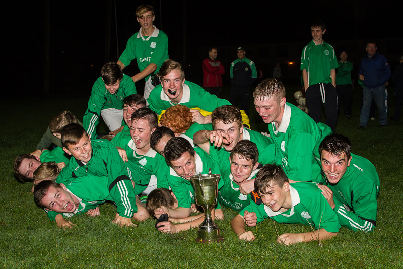 The Shamrocks U16's celebrate with the cup under the Ballygarvan floodlights.