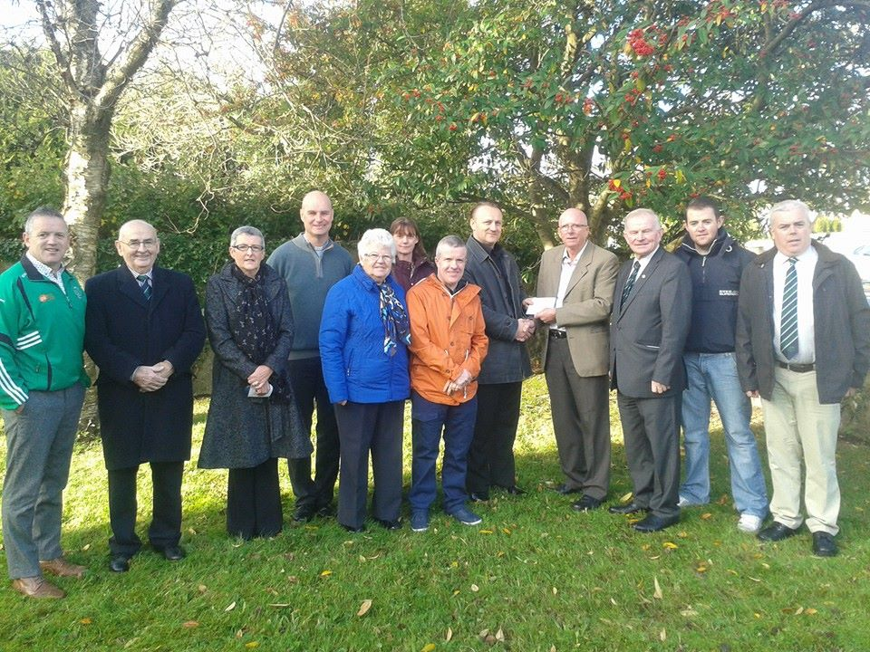 Club Chairman Pat McCarthy presents Wojciech Garbuz of The Oratory Restoration Project a donation from the club. From left: Dick Andrews (underage), Michael Brennan (Club President) Helen Prout (Club Vice President), Fr Seán PP, Gertie O'Driscoll (Oratory Restoration Project), Geraldine Twomey, Kieran O'Flaherty (Oratory Restoration Project), Wojciech Garbuz (Oratory Restoration Project), Pat McCarthy (Club Chairperson), John Twomey (Treasurer), Jonathan Tuohy (underage Secretary), John Twomey (Underage Chairperson)