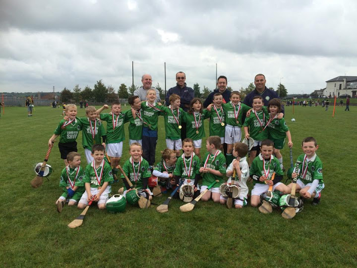 Seamus O'Flynn, Stephen Keane, Shane O'Donovan and John Jordan with the u8 hurling blitz teams in Na Piarsaighs GAA on 10/10/15