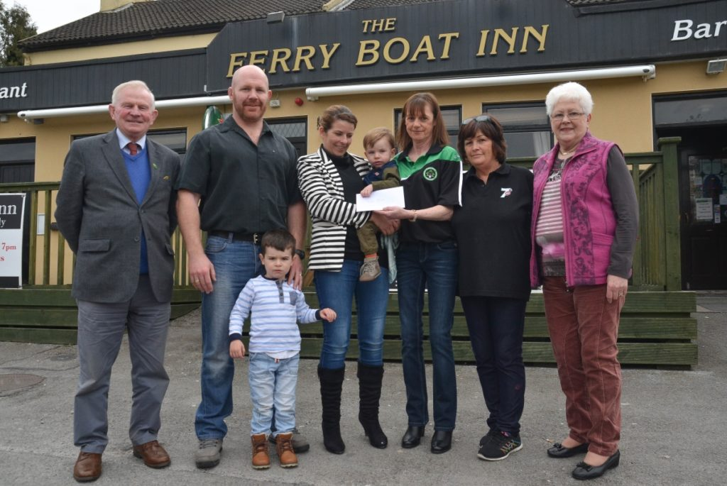 Little Noah Sisk receives his prize as winner of the recent Shamrocks GAA Club Lotto from draw co-ordinator Geraldine Twomey in Ringaskiddy last weekend. Also pictured are John Twomey, Club Treasurer; Padraic, Aaron and Lisa Sisk; Chris Davis, Ferryboat Inn and Shiela Sisk. Picture: Howard Crowdy